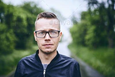 Man with eyeglasses in rain