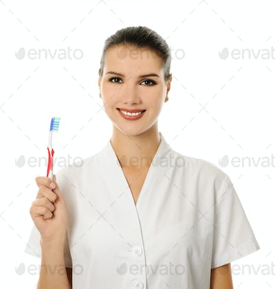 cheerful female doctor with toothbrush
