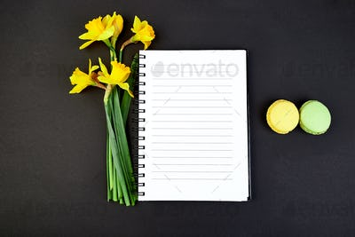 Top view flat lay empty notebook with spring flowers