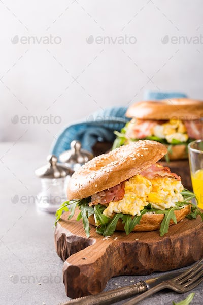 Freshly baked bagel filled with scrambled eggs