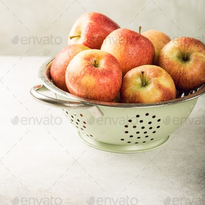 Colander with ripe red apples
