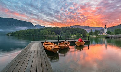 Vivid summer sunrise at Lake Bohinj in Slovenia