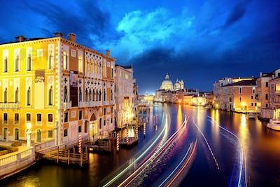 The Grand Canal and Basilica Santa Maria della Salute during night with gondolas, Venice, Italy