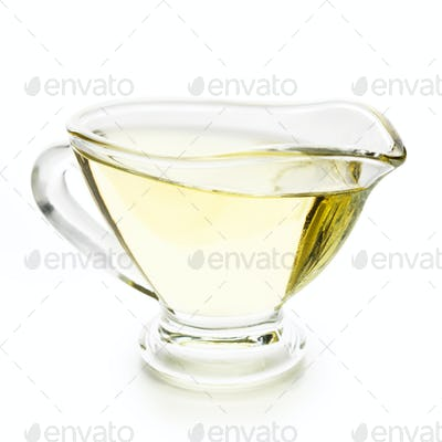 Olive oil in glass jar on white