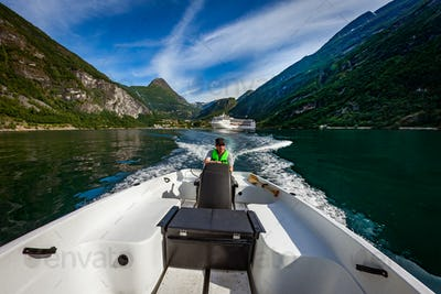 Man driving a motor boat. Geiranger fjord, Beautiful Nature Norw