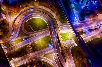 Night Aerial view of a freeway intersection traffic trails in ni