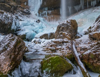Pericnik waterfall in winter. Frozen waterfall in the middle of the Alps.