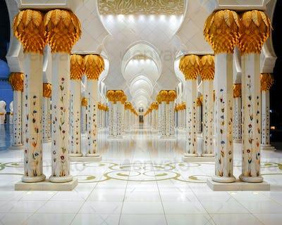 ABU DHABI, UAE - MAR 19, 2014: Corridor with columns at Mosque, Abu Dhabi, United Arab Emirates.