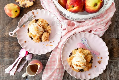 Peach crumble with a scoop of ice cream