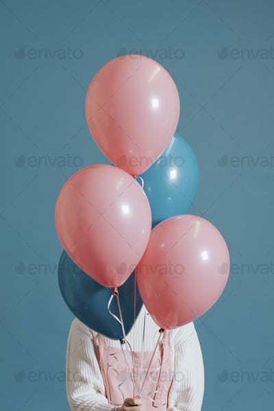 Girl covered with ballons