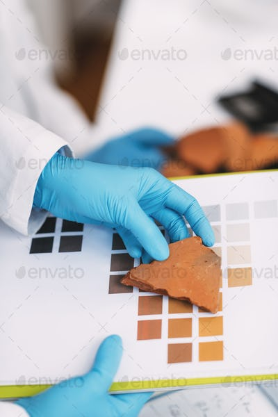 Archaeologist Compares Pottery Color