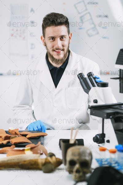 Portrait of Young Male Archaeology Student in Laboratory