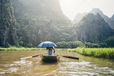 Boat with tourists against karst formation