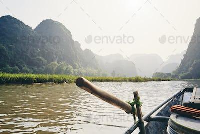 Rowboat against karst formation