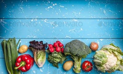 Fresh organic vegetables on rustic background