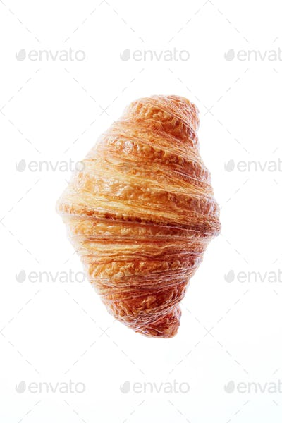 Close up french freshly baked croissant on a white background