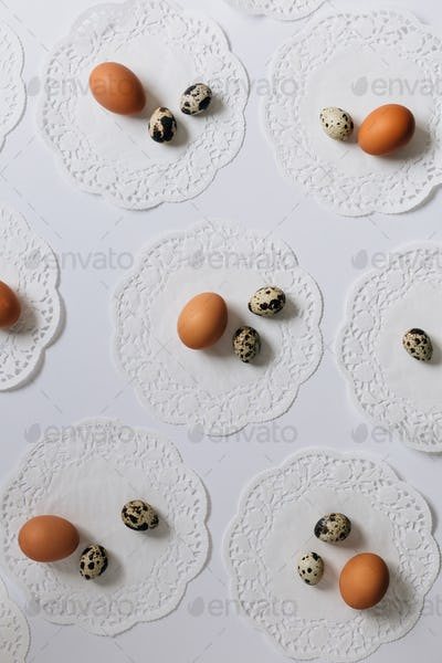 Eggs and Vintage Doilies on White Table