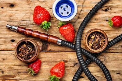 Smoking shisha on strawberry