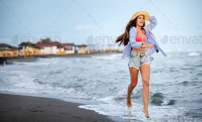 Beautiful sexy woman on beach while summer vacation