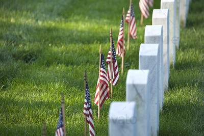 American flags in front of tombstones at Arlington National Cemetery for Memorial Day