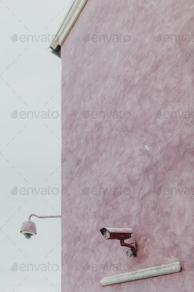 CCTV on a pink wall
