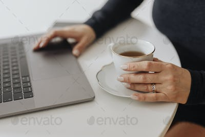 Relaxed woman working from home