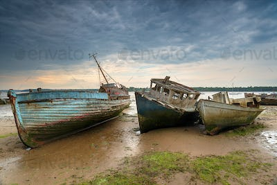Old abandoned fishing boats on the River Orwell