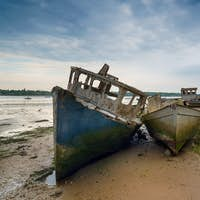 Old wrecked boats on the River Orwell