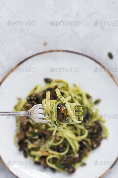 Close-up of Linguine and Pesto Twisted on Fork