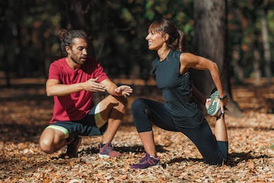 Young Couple stretching after training in the park