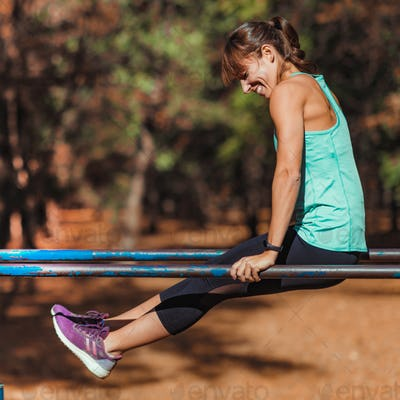 Exercising on parallel bar in the park