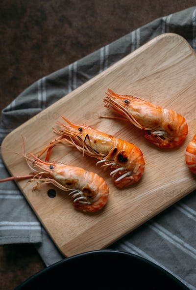 Cooked shrimp on wooden board