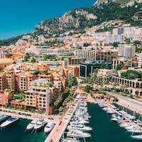 Monaco, Monte Carlo. Yachts Moored Near City Pier, Jetty In Sunn