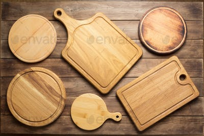 cutting board at wooden plank table