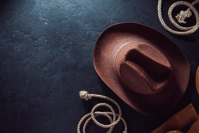 cowboy hat at table wooden background