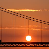 Traffic On Bridge With Red Sunset