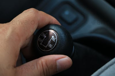 Hand on 4x4 gear stick