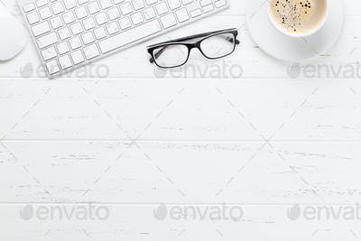 Office workplace table with coffee and computer