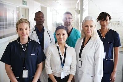 Portrait Of Medical Team Standing In Hospital Corridor