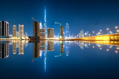 Fascinating reflection of tallest skyscrapers in Business Bay district, Dubai, United Arab Emirates.