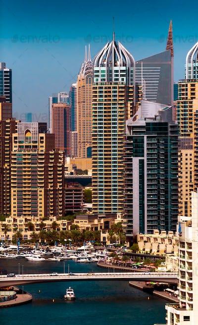 Amazing colorful dubai marina skyline during sunny day, Dubai, United Arab Emirates.