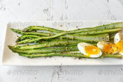 Bunch of cooked asparagus with egg