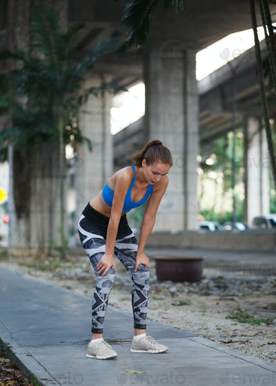 young female in sportswear fitness training outdoor