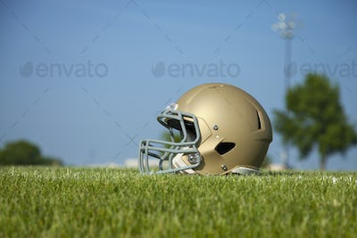 Low angle view of football helmet on grass field