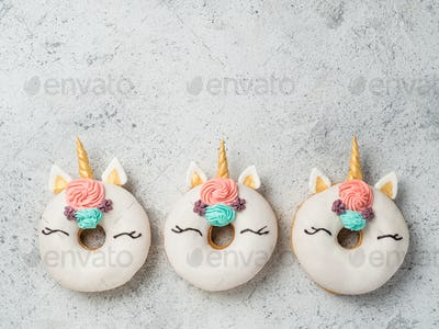 Unicorn donuts with copy space