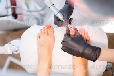 Beautician salon, pedicure, polish procedure