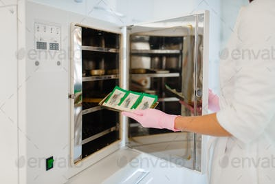Antibacterial cabinet, beautician cleans tools