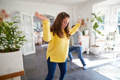 Young Downs Syndrome Couple Having Fun Dancing At Home Together
