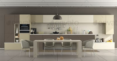 Beige and brown modern kitchen with dining table and chairs - 3d rendering