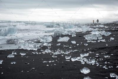 Diamond beach in Iceland on the Atlantic ocean coast. Icebergs from Jokulsarlon glacier lagoon